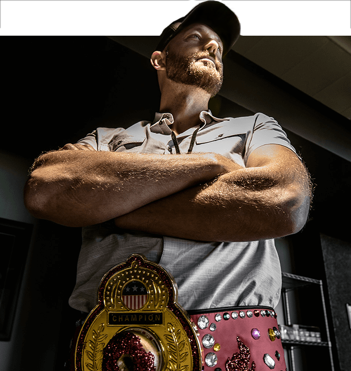 certain affinity employee wearing championship belt